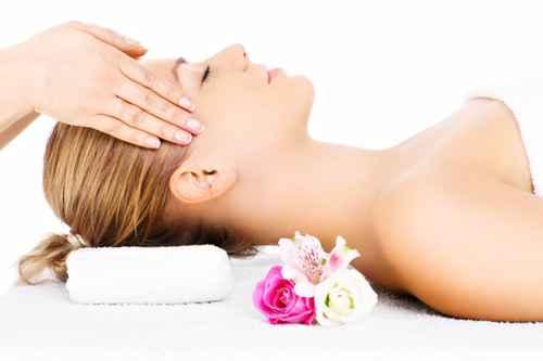 Woman having head massage